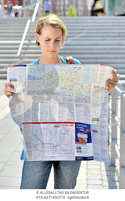 Woman holding a map