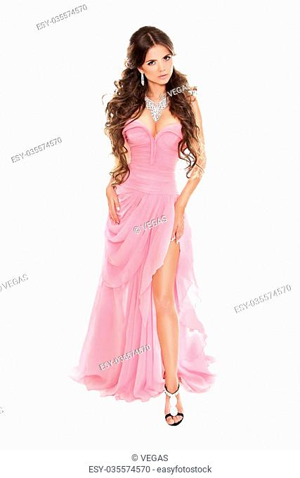 Full-length portrait of fashion woman in romantic pink dress isolated on white background