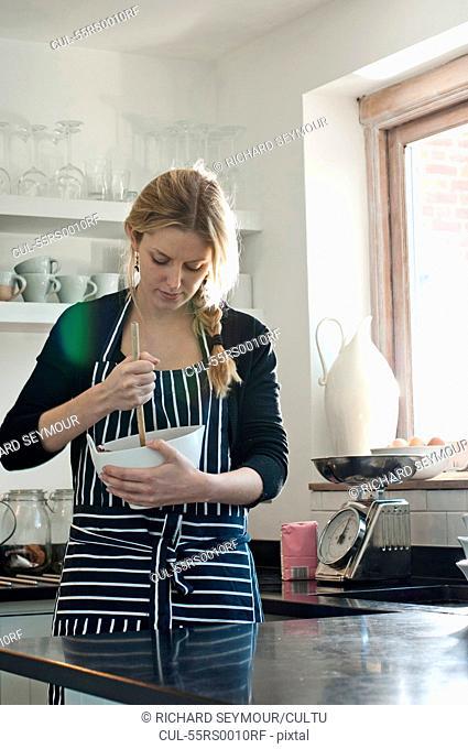 Woman stirring cake mixture