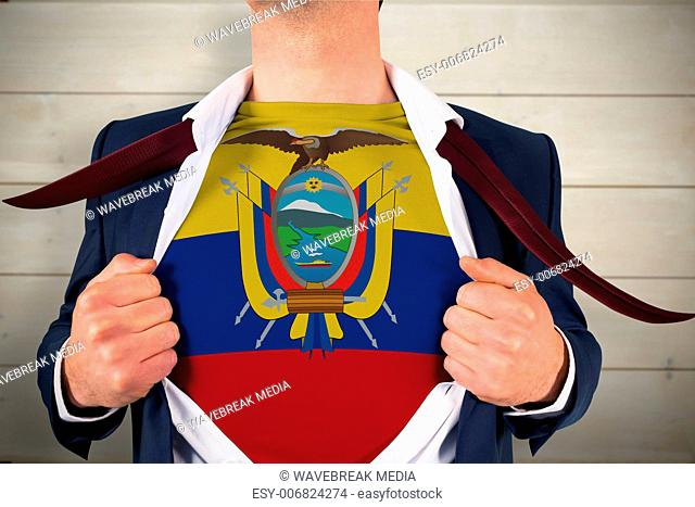 Composite image of businessman opening shirt to reveal ecuador flag