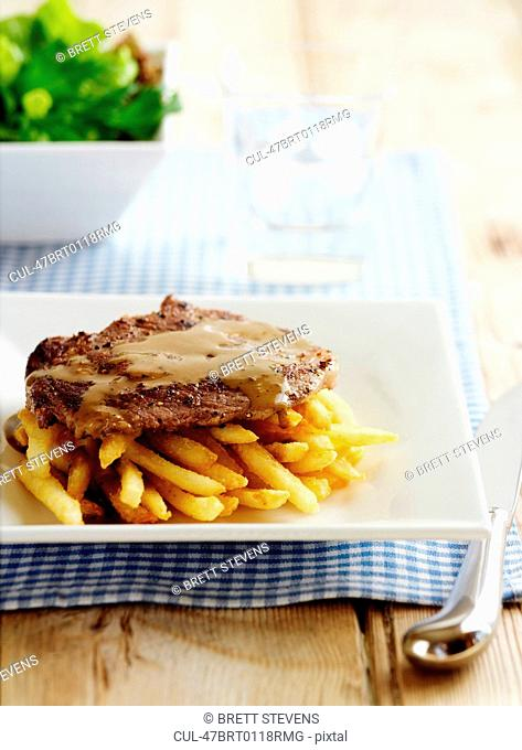 Plate of steak with fries
