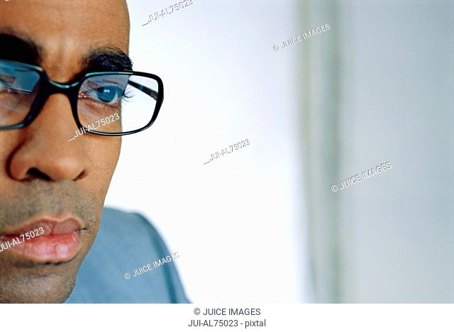 View of man with glasses concentrating