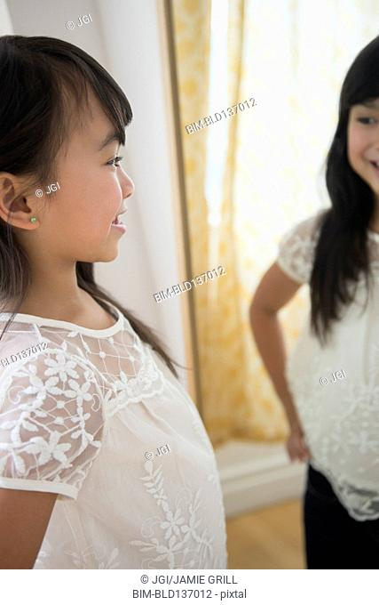 Filipino girl admiring herself in mirror