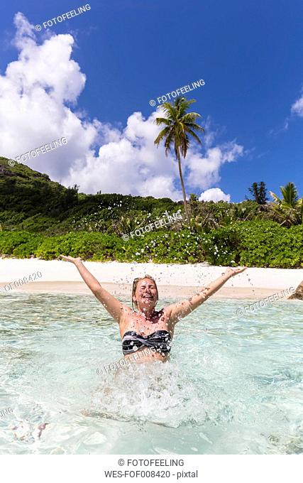 Seychelles, Anse Cocos, female tourist in water