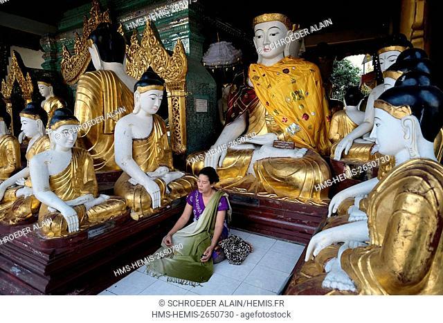 Myanmar, Yangon, devotee in Shwedagon Pagoda