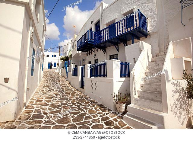 Whitewashed houses with blue painted doors and balconies in the old town Chora or Chorio, Kimolos, Cyclades Islands, Greek Islands, Greece, Europe