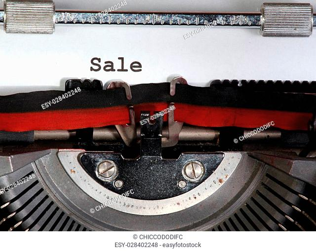 sale written with black ink with the typewriter