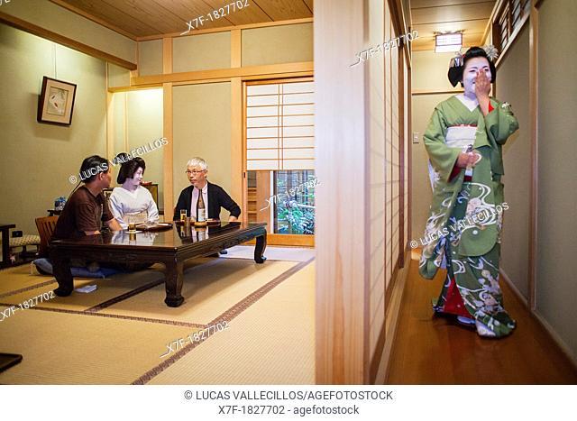 Fukuyu,geisha and Fukukimi,'maiko' geisha apprentice workimg in Miyaki tea house o-chaia Geisha's distric of Miyagawacho Kyoto  Kansai, Japan