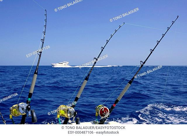 Blue sea and sky in a big game tuna fishing day rods and reels on boat