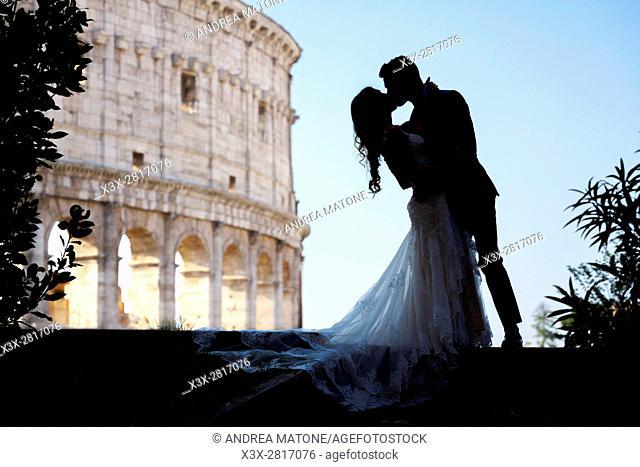Wedding Couple silhouette. Roman Colosseum. Rome, Italy