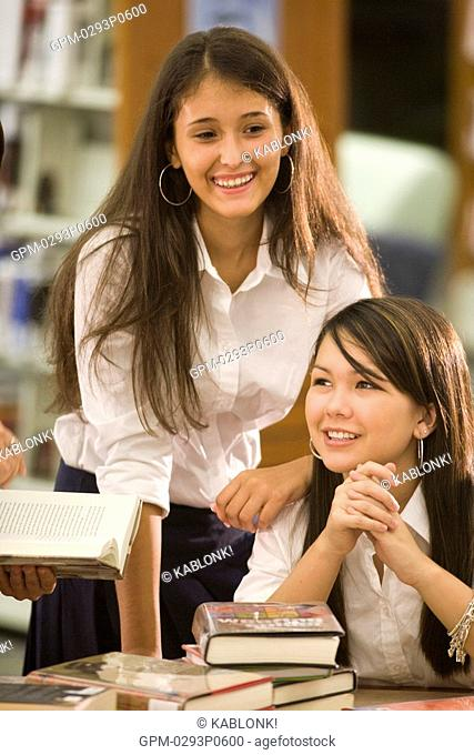 Two high school students in library