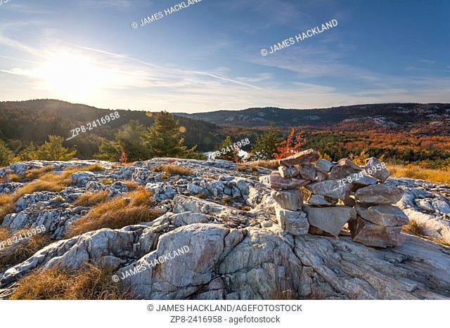 A rock cairn marking the trail along an open ridge in Killarney Provincial Park, Ontario, Canada