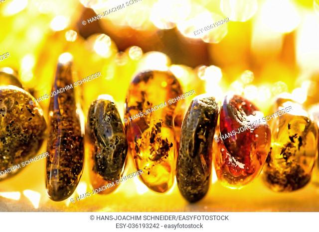 amber bracelet in the sun
