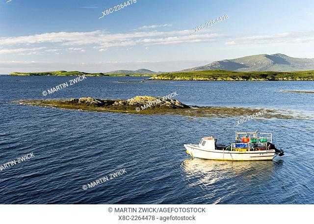 The island Benbecula (Beinn nam Fadhla) in the Outer Hebrides. The mountains of South Uist in the background. Europe, Scotland, June
