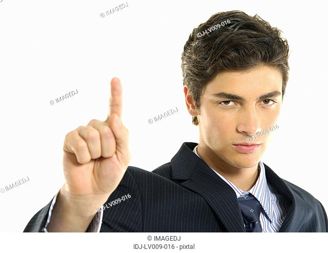 Portrait of a businessman pointing and looking serious