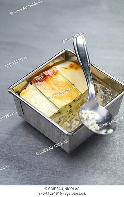 Goat's cheese and courgette terrine in a metal container