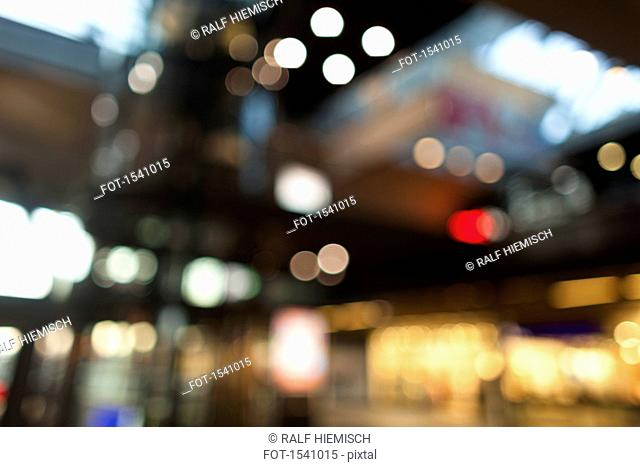 Defocused image of illuminated building in city