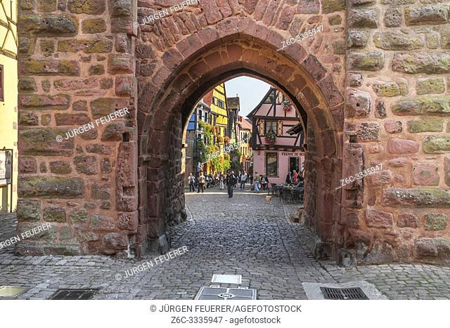 view through town gate to old village, Riquewihr, Alsace, France, historical timber architecture