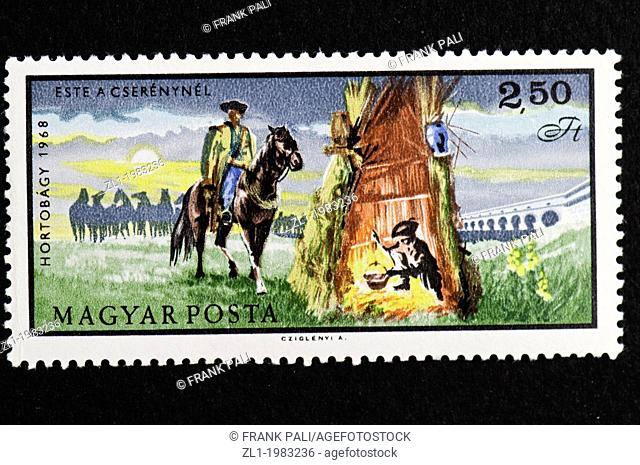 This is the Hortobagy series hungarian postage stamps showing the hungarian horsesmen doing the every day jobs.Here they are on guard through the night
