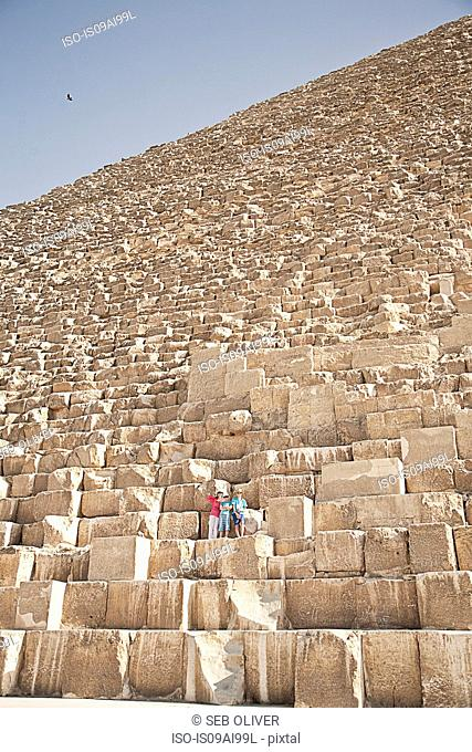 Mother and sons, tourists at The Great Pyramid of Giza, Egypt