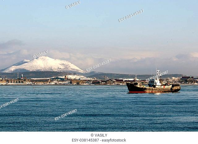 a fishing vessel on the background of winter