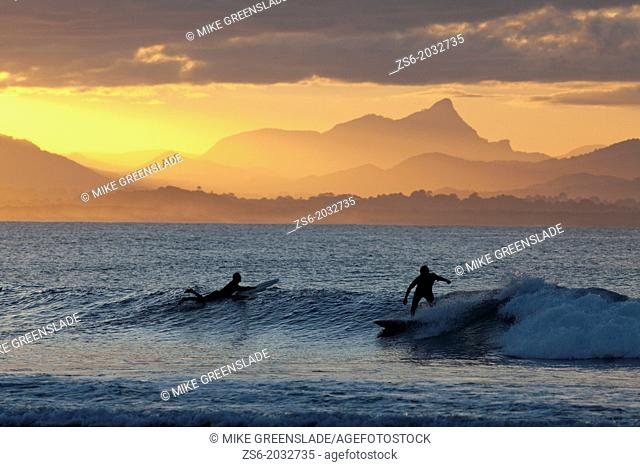 Surfersat sunset, The Pass, Byron Bay, New South Wales, Australia