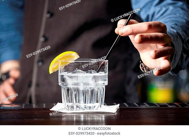 This is closeup of barman serving cocktail