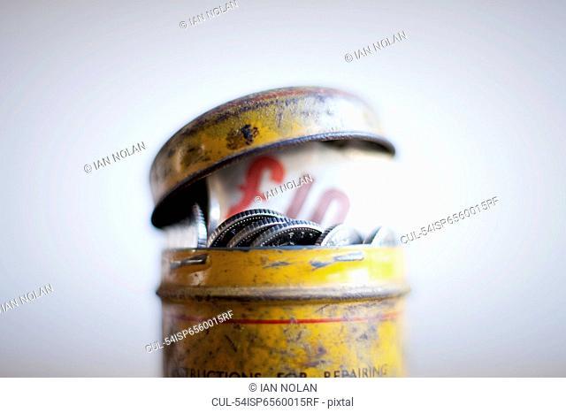 Antique tin full of money on desk