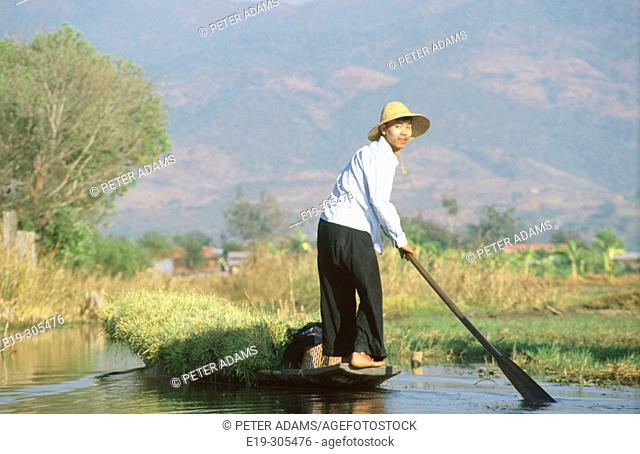 Man with boat in Inle Lake. Myanmar
