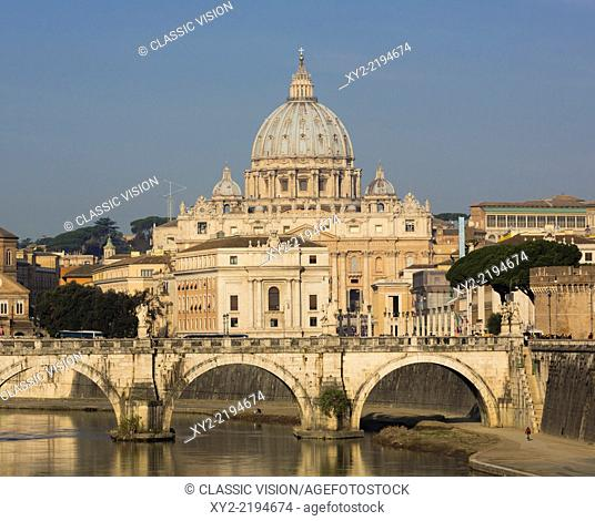 Rome, Italy. St Peter's Basilica. Tiber river and Sant'Angelo Bridge in foreground