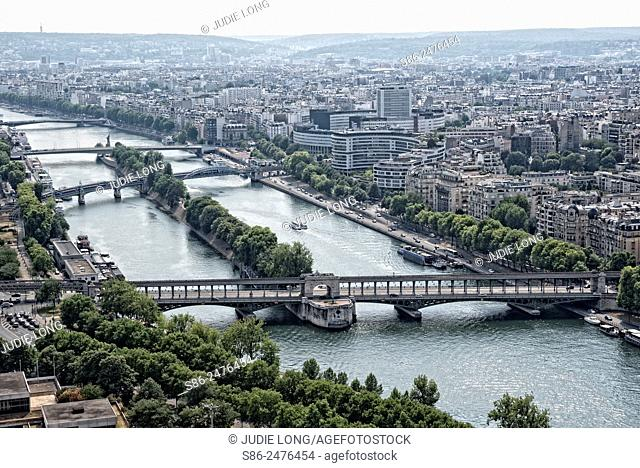 Looking Down from the Eiffel Tower at the Beautiful City of Paris, France. River Seine and Bridge in the Foreground