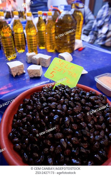 Olives and Olive-oil bottles for sale at the market place in Selcuk, Lycia, Izmir Province, Aegean Coast, Turkey, Europe