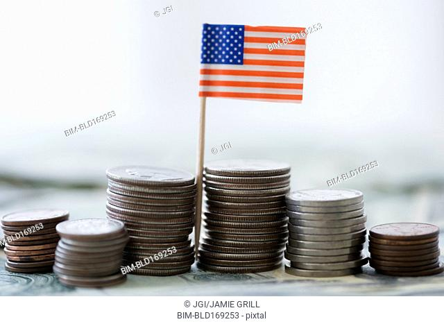Close up of stacks of coins with American flag