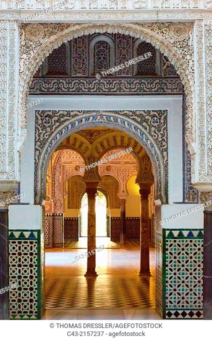 The Salon of the Ambassadors in the Alcázar of Seville seen through the doorway of the Courtyard of the Dolls. Seville province, Andalusia, Spain