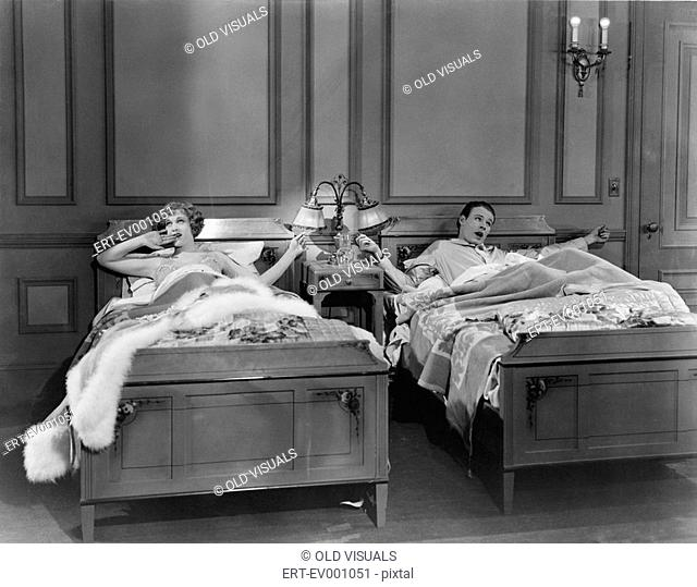 TWIN BEDS All persons depicted are not longer living and no estate exists Supplier warranties that there will be no model release issues