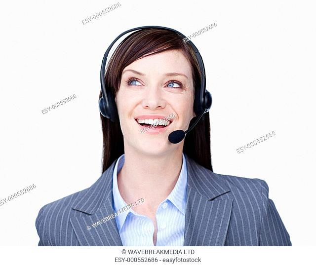 Laughing businesswoman with headset on against a white background