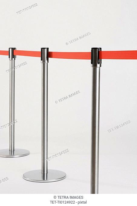 Studio shot of retractable belt crowd control barriers