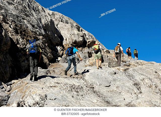 Hikers crossing the exposed bedrock of Tsanfleuron Glacier, Canton of Valais, Switzerland