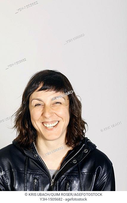 Studio shot of woman, laughing