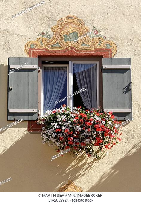 Window with Lueftlmalerei, frescoes on facade, and geraniums, Neubeuern, Inn Valley, Chiemgau region, Upper Bavaria, Bavaria, Germany, Europe