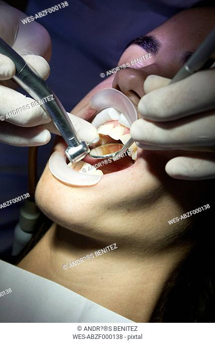 Dentist treating patient's mouth