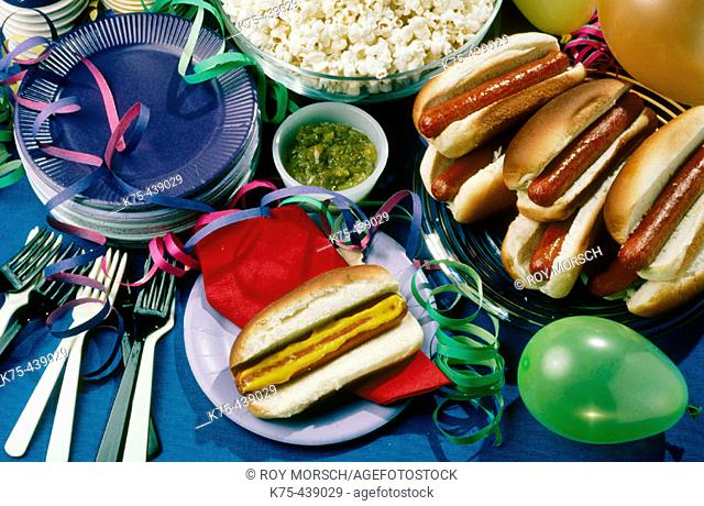 Hot dogs with condiments and popcorn for picnic