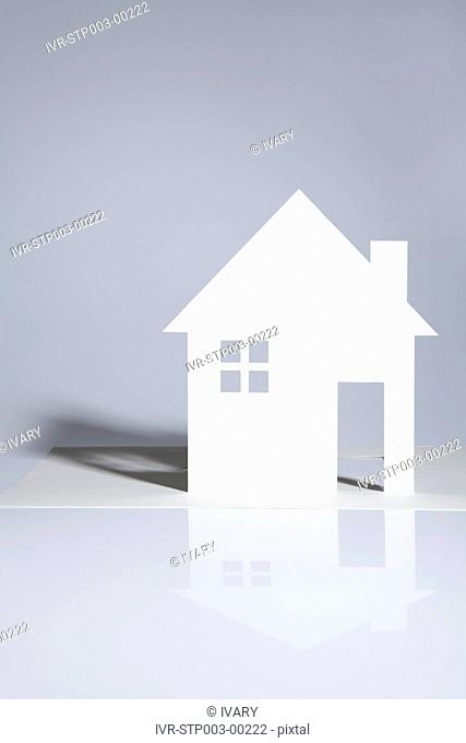 Architectural model of house against colored background