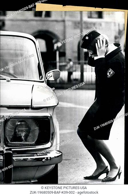 May 09, 1968 - This beautiful traffic warden has an idle motorist in her eye. 'Where are you flying?' the woman is often asked