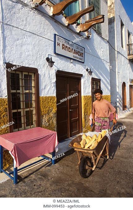 Dodecanese, Kastellorizo Kastellorizo port / town bread vendor with wheel barrel