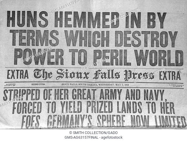 Huns Hemmed in By Terms Which Destroy Power to Peril World, newspaper front page headline for the Sioux Falls Press announcing the surrender of Germany during...