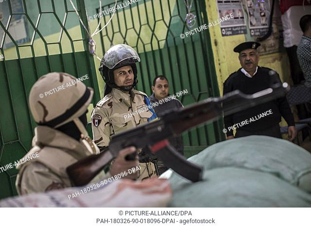 Egyptian military and police stand guard outside a polling station on the first day of the 2018 Egyptian presidential elections, in Cairo, Egypt, 26 March 2018