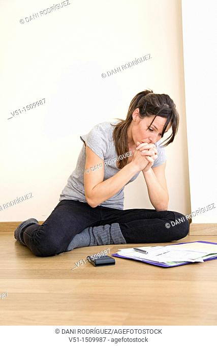 Young woman bookkeeping