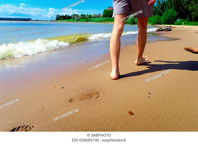 Legs on the Seashore at the Edge of the Water