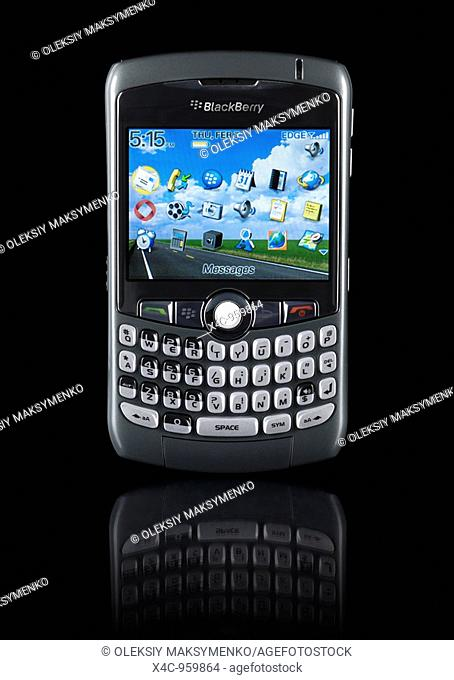 BlackBerry 8310 Curve stylish smartphone with illuminated display Isolated silhouette on black background with clipping path